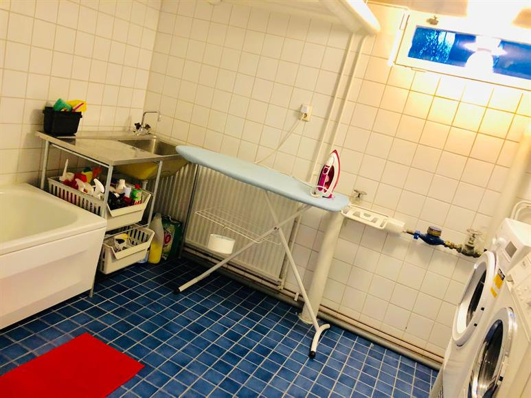Large Bathroom 2 + Laundry Room Lower Floor