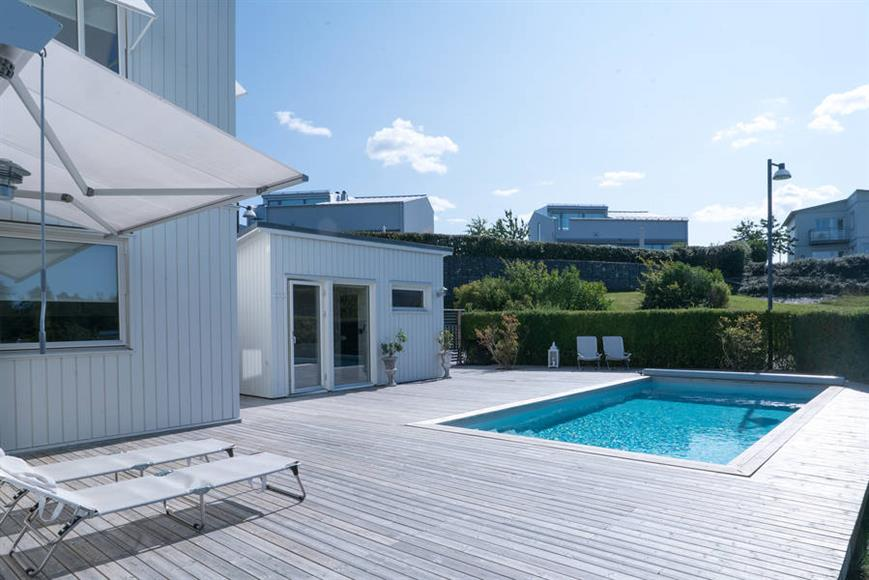 A sun-deck with a warm pool
