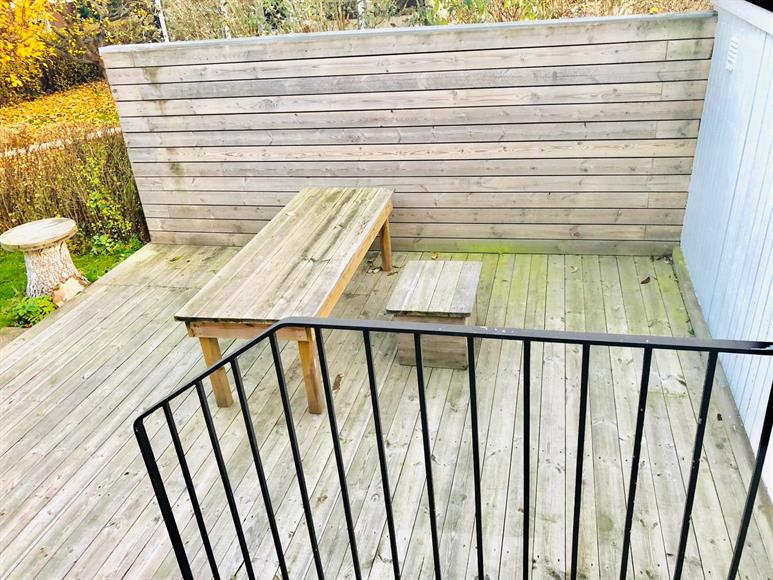 Patio 1 - Wooden Deck on one side of the house